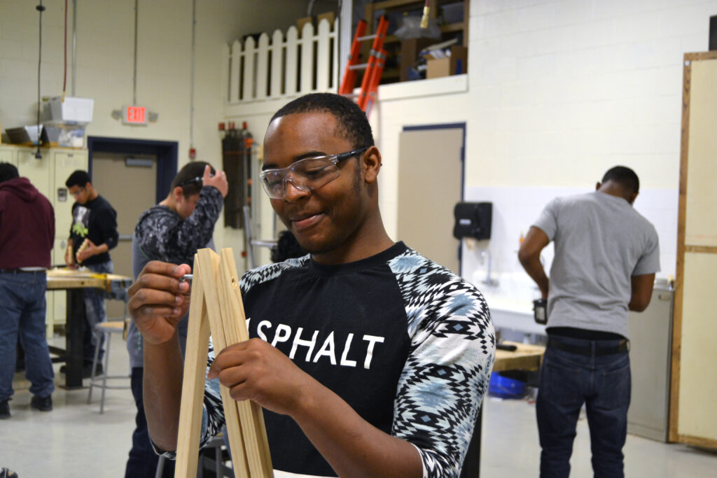 Student working on a woodcraft project