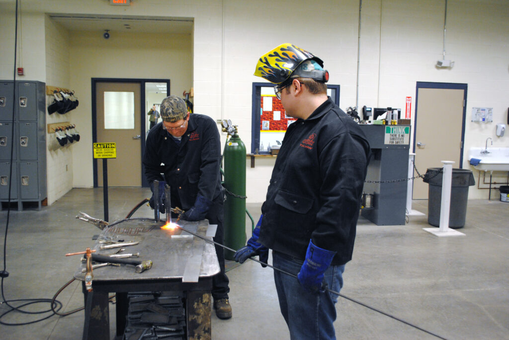 Teacher and student welding